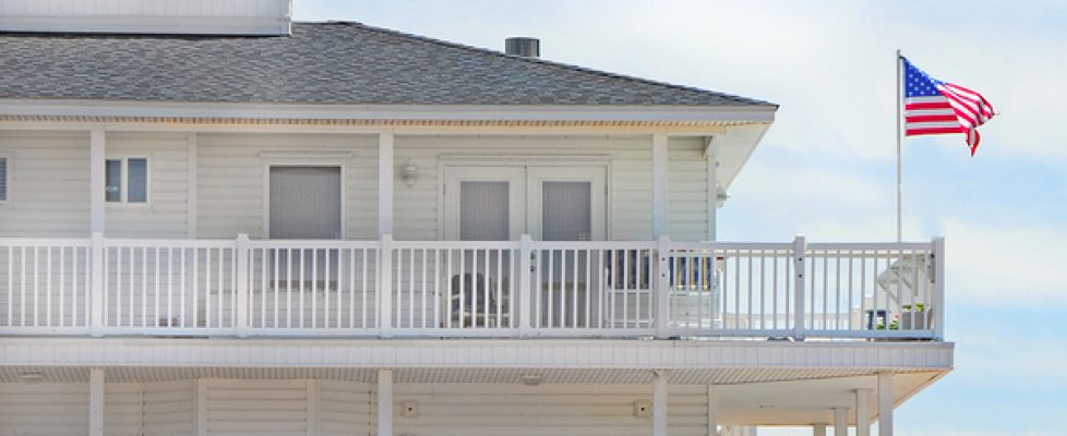 Oceanside property with American Flag blowing in the wind